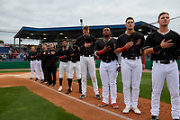 Batavia Muckdogs (L-R) Tom Lawless, Rigoberto Silverio, Jordan Wheat, Justin Weiss, Nasim Nunez, Milton Smith II, Sean Reynolds, Albert Guaimaro, Nic Ready, and Troy Johnston stand for the national anthem before a NY-Penn League Semifinal Playoff game against the Lowell Spinners on September 4, 2019 at Dwyer Stadium in Batavia, New York.  Batavia defeated Lowell 4-1.  (Mike Janes/Four Seam Images)