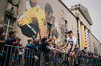 After being attacked in public by former cycling legend Bernard Hinault in the weeks preceeding the Tour  start, Chris Froome (GBR/SKY) now rolls past a huge mural of 'The Badger' at the Team presentation in La Roche-sur-Yon.<br /> <br /> Le Grand Départ 2018<br /> 105th Tour de France 2018<br /> ©kramon