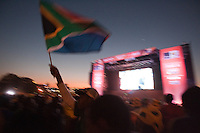 South African fans fly a national flag after watching South Africa play France at the FIFA Fan Fest in Sandton, South Africa during the 2010 FIFA World Cup first round match Africa and France on Tuesday, June 22, 2010.   South Africa defeated France 2-1, but failed to qualify for the second round.