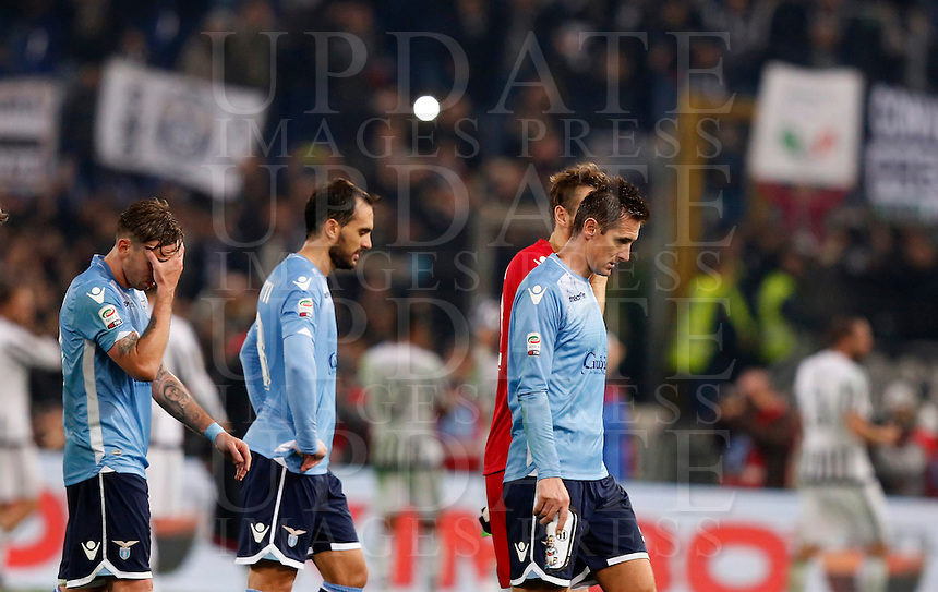 Calcio, Serie A: Lazio vs Juventus. Roma, stadio Olimpico, 4 dicembre 2015.<br /> Lazio players, from left, Lucas Biglia, Santiago Gentiletti, Federico Marchetti, partially seen, and Miroslav Klose leave the pitch at the end of the Italian Serie A football match between Lazio and Juventus at Rome's Olympic stadium, 4 December 2015. Juventus won 2-0.<br /> UPDATE IMAGES PRESS/Riccardo De Luca