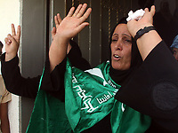 "Mother of Emad Abu Ahjayer,  Leader of Alqassam Brigads loyal Hamas movement  react during his funeral in the Bureij refugee camp, central Gaza Strip, Thursday, Sept. 21, 2007. Israeli troops operating against rocket squads in Gaza .""photo by Fday Adwan"""