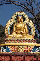 """Nepal, Kathmandu, Swayambhunath.  Buddha Statue Demonstrating the """"Earth is my Witness"""" Gesture.  (Bhumisparsha Mudra)."""