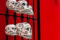 Hand-painted skulls (Calaveras) are seen placed on a street door during the Day of the Dead festivities in Oaxaca, Mexico, 31 October 2019. Day of the Dead (Día de Muertos), a religious holiday combining the death veneration rituals of Pre-Hispanic cultures with the Catholic practice, is widely celebrated throughout all of Mexico. Based on the belief that the souls of the departed may come back to this world on that day, people gather together while either praying or joyfully eating, drinking, and playing music, to remember friends or family members who have died and to support their souls on the spiritual journey.