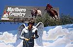Warren Beatty Heaven Can Wait billboard with Marlboro Cowboy, Sunset Strip, 1978
