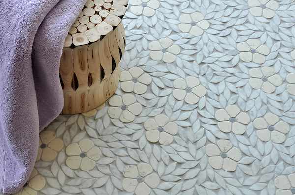 Jacqueline, a natural stone waterjet mosaic in tumbled Bianco Antico, Bardiglio, and Carrara, is part of the Silk Road® collection by New Ravenna.
