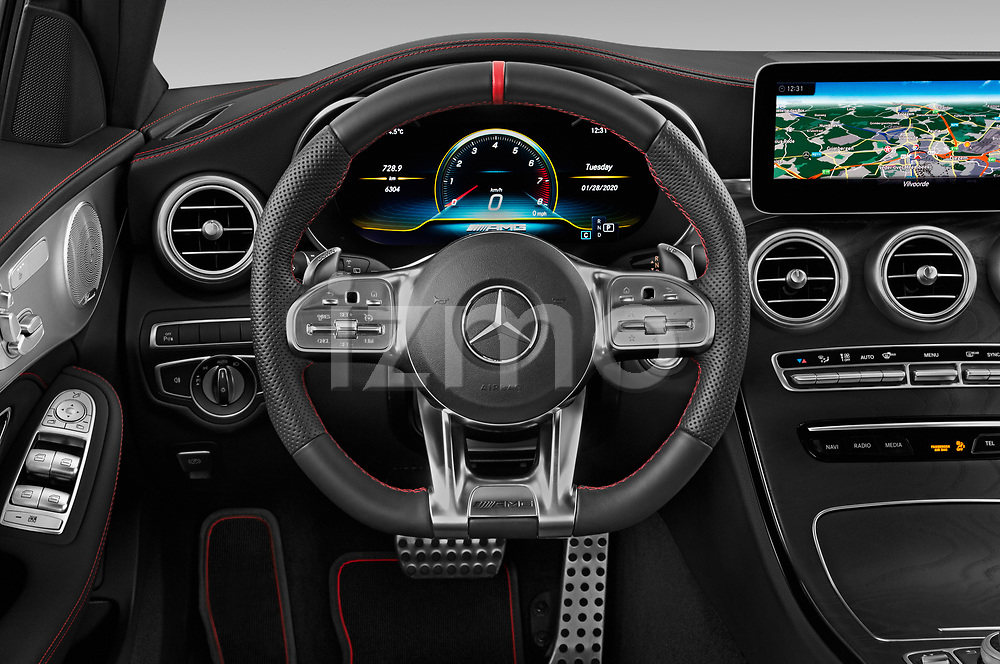 Car pictures of steering wheel view of a 2020 Mercedes Benz C Class Break 43 AMG 5 Door Wagon