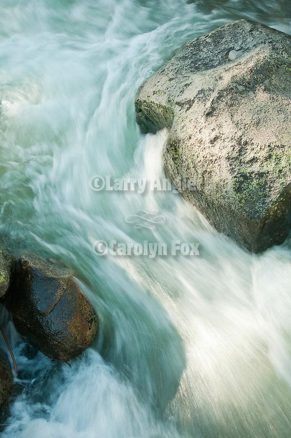 Spring runoff flows down Cole Creek, El Dorado National Forest, Amador County, Calif.