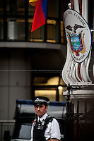 """A police officer outside the Ecuadorian Embassy.<br /> <br /> London, 19/08/2012. Today, Julian Assange made his first speech after two months (19th June 2012) he has been living as a refugee in the Ecuadorian Embassy in London.<br /> <br /> For more pictures on this event click here: <a href= """"http://bit.ly/Pqmp6X""""> http://bit.ly/Pqmp6X</a>"""