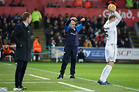 Paul Cook, manager for Wigan Athletic (C) reacts on the touch line during the Sky Bet Championship match between Swansea City and Wigan Athletic at the Liberty Stadium, Swansea, Wales, UK. Saturday 29 December 2018