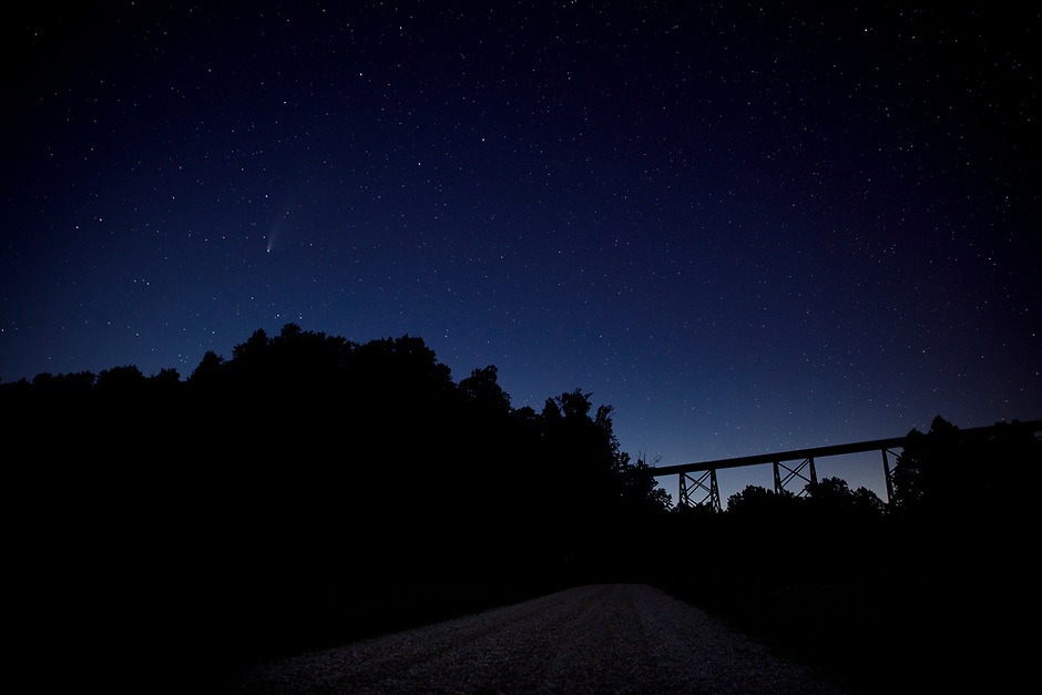 Comet NEOWISE is seen in the night sky near the Tulip Viaduct in rural Greene County, Indiana on Thursday, July 23, 2020. The comet, also known as C/2020 F3, is three-miles wide in diameter traveling at 144,000 mph about 70 million miles from Earth. (Photo by James Brosher)