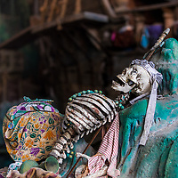 Pirates of the Caribbean skeleton and treasure chest with a blurred boat in the background, Universal Studios Florida theme park, Orlando, USA