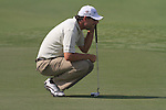 Dubai World Championship Golf. Earth Course,.Jumeirah Golf Estate, Dubai, U.A.E...Padraig Harrington lines up his putt on the 5th during the second round of the Dubai World Golf championship..Photo: Fran Caffrey/www.golffile.ie...