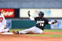 San Antonio Missions outfielder Yeison Asencio (14) slides into second after hitting a double during a game against the Arkansas Travelers on May 24, 2014 at Dickey-Stephens Park in Little Rock, Arkansas.  Arkansas defeated San Antonio 4-2.  (Mike Janes/Four Seam Images)