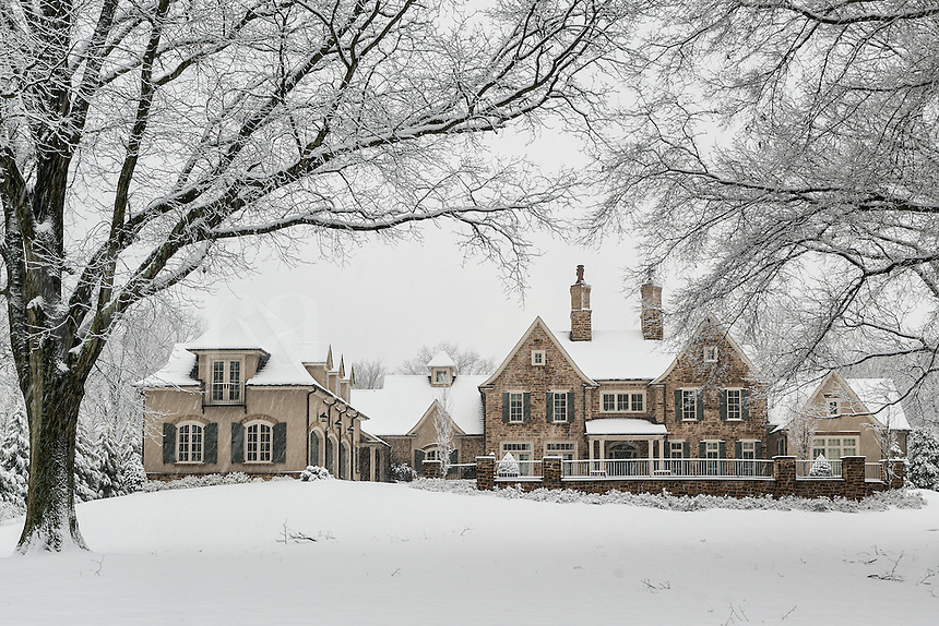 Grand country estate shrouded in winter snow.