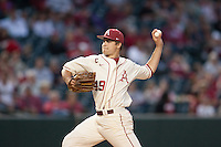 Arkansas Razorbacks pitcher Jalen Beeks (49) pitching at Baum Stadium during the NCAA baseball game against the Alabama Crimson Tide on March 21, 2014 in Fayetteville, Arkansas.  The Alabama Crimson Tide defeated the Arkansas Razorbacks 17-9.  (William Purnell/Four Seam Images)