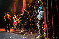 Confetti falls over performers from the Cape Town College of Magic at the end of a show at the Artscape Theatre.