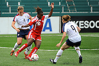 Jodi-Ann Robinson (10) of Canada (CAN) maneuvers between Cat Whitehill (4) and Heather O'Reilly (9) of the United States (USA). The United States (USA) Women's National Team defeated Canada (CAN) 1-0 during an international friendly at Marina Auto Stadium in Rochester, NY, on July 19, 2009.