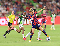AUSTIN, TX - JUNE 16: Kristie Mewis #22 of the United States battles Ijeoma Esther Okoronkwo #12 of Nigeria for the ball during a game between Nigeria and USWNT at Q2 Stadium on June 16, 2021 in Austin, Texas.