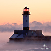 """""""Steamy Sunrise"""" ~ Canal Park's lighthouse stands among Lake Superior's sea smoke during a subzero sunrise in Duluth."""