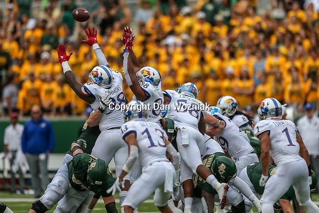 Kansas Jayhawks defensive lineman KeyShaun Simmons (98), Kansas Jayhawks defensive tackle J.J. Holmes (88) in action during the game between the Kansas Jayhawks and the Baylor Bears at the McLane Stadium in Waco, Texas.