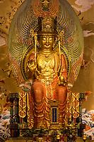 Buddha Maitreya, the Future Buddha, in Main Prayer Hall. Buddha Tooth Relic Temple, Singapore.  The Buddha displays the abhaya mudra gesture, which dispells fear.
