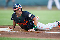 Miami Hurricanes second baseman George Iskenderian (7) looks towards the umpire after diving back to first base against the Florida Gators in the NCAA College World Series on June 13, 2015 at TD Ameritrade Park in Omaha, Nebraska. Florida defeated Miami 15-3. (Andrew Woolley/Four Seam Images)