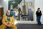 Bernard Buffet French artist expressionist painter (1928-1999) France Circa 1995. His studio at home Tourtour Provence France with wife Annabel Schwob. The painting is of his family with Annabel seated. 1994.