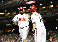 Apr. 25, 2011; Phoenix, AZ, USA; Arizona Diamondbacks outfielder Justin Upton (left) is congratulated by teammate Ryan Roberts after scoring in the sixth inning against the Philadelphia Phillies at Chase Field. The Diamondbacks defeated the Phillies 4-0. Mandatory Credit: Mark J. Rebilas-
