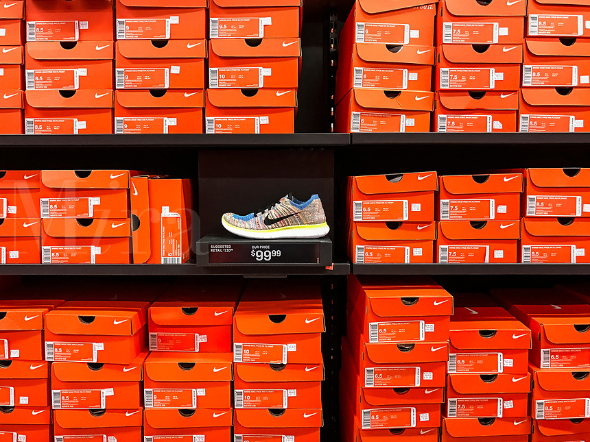 Nike training shoe display in a Nike store.