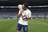 DENVER, CO - JUNE 6: Sebastian Lletget celebrates winning the CONCACAF Nations League Cup during a game between Mexico and USMNT at Mile High on June 6, 2021 in Denver, Colorado.