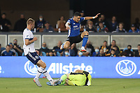 SAN JOSE, CA - AUGUST 13: Cristian Espinoza #10 of the San Jose Earthquakes jumps over Maxime Crepeau #16 of the Vancouver Whitecaps during a game between Vancouver Whitecaps and San Jose Earthquakes at PayPal Park on August 13, 2021 in San Jose, California.