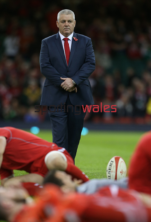 Wales coach Warren Gatland oversees the teams warm up session before kick off.<br /> Dove Men Series 2014<br /> Wales v Australia<br /> Millennium Stadium<br /> 08.11.14<br /> ©Steve Pope-SPORTINGWALES