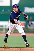 Jeff Bianchi (6) of the Northwest Arkansas Naturals tosses a ball to first base during a game against the San Antonio Missions at Arvest Ballpark on June 30, 2011 in Springdale, Arkansas. (David Welker / Four Seam Images)