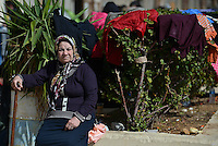 Pictured: A migrant woman takes shelter at the passenger terminal in Piraeus port, Greece Sunday 28 February 2016<br /> Re: Hundreds of migrants have arrived from the Greek islands to Piraeus Port, Greece