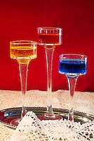 Arrangement of glasses with colored water.