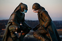 The sculptures of George Washington and the Seneca leader Guyasut are shown, covered in face masks, at the Points of View Park in Mt Washington on Sunday March 29, 2020 in Pittsburgh, Pennsylvania. (Photo by Jared Wickerham/Pittsburgh City Paper)