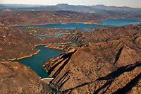aerial photograph of Lake Berryessa, Napa County, California; Monticello Dam is visible in the foreground; the ring around the shoreline of the lake reveals the low lake levels.