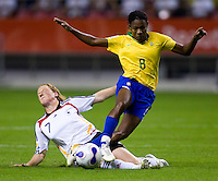 Brazil forward (8) Formiga is fouled by German midfielder (7) Melanie Behringer during the FIFA Women's World Cup final at Hongkou Stadium in Shanghai, China on September 30, 2007. Germany defeated Brazil, 2-0.