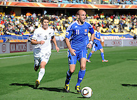 Robert Vittek of Slovakia and Tony Lochhead of New Zealand
