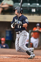 Pulaski Mariners third baseman Jay Baum #17 swings at a pitch during a game against the Greenville Astros at Pioneer Park July 12, 2014 in Greenville, Tennessee. The Mariners defeated the Astros 11-10. (Tony Farlow/Four Seam Images)