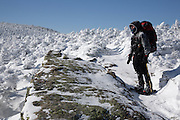 Winter hiker on North Twin Trail during the winter months in the White Mountains, New Hampshire USA