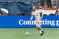 FOXBOROUGH, MA - OCTOBER 7: Laurent Ciman #26 of Toronto FC brings the ball forward during a game between Toronto FC and New England Revolution at Gillette Stadium on October 7, 2020 in Foxborough, Massachusetts.