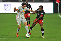 WASHINGTON, DC - SEPTEMBER 12: Sean Nealis #15 of New York Red Bulls battles for the ball with Ola Kamara #9 of D.C. United during a game between New York Red Bulls and D.C. United at Audi Field on September 12, 2020 in Washington, DC.