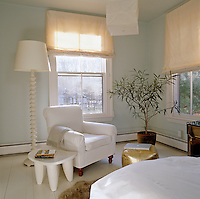 The walls of the bedroom are painted a grayish blue to remind Sharon Simonaire of the New York sky