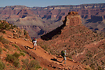 Couple hiking on the South Kaibab Trail descending Cedar Ridge, South Rim in Grand Canyon National Park, northern Arizona. .  John leads hiking and photo tours throughout Colorado. . John offers private photo tours in Grand Canyon National Park and throughout Arizona, Utah and Colorado. Year-round.
