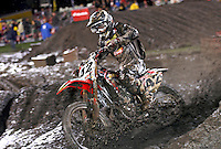Action in the rain and mud at the Daytona Supercross, Daytona International Speedway, Daytona Beach FL March 7, 2008. (Photo by Brian Cleary/www.bcpix.com)