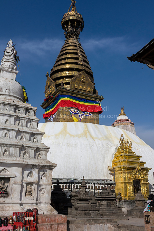 Nepal, Kathmandu, Swayambhunath.  The Stupa, with Shrine to the Buddha lower right.   The 13 tapering levels above the dome, representing the 13 stages of perfection leading to nirvana.  The main stupa survived the earthquake of April 2015, but the remainder of the complex was severely damaged.