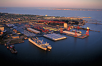 Port area with navy and civilian ships on the James River (area also known as Hampton Roads). Large coal export facility and the I-664 Bridge Tunnel in center of photo. Norfolk is in the distance across the water at the mouth of the Chesapeake Bay. Newpor