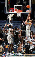WASHINGTON, DC - FEBRUARY 19: Jamorko Pickett #1 of Georgetown lobs a shot over Emmitt Holt #15 of Providence during a game between Providence and Georgetown at Capital One Arena on February 19, 2020 in Washington, DC.