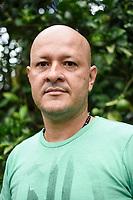 ARMENIA - COLOMBIA, 24-05-2021: Richard Hurtado es un policía retirado, en su finca produce huevos y plátanos, también cuenta con terneros y cerdos; en la crisis de no poder encontrar alimento para sus 170 gallinas, contempló la idea de sacrificarlas ya que varias estaban empezando a debilitarse por la falta de comida. A más de un mes del inicio del Paro Nacional, los campesinos han tenido que reinventar la forma para mantener sus cultivos y criaderos activos para minimizar las pérdidas por los bloqueos que aún se mantienen en las vías. Según cifras del Ministerio de Hacienda, las pérdidas diarias están en un monto de $480.000 millones de pesos colombianos, lo cual sumando la totalidad de los días del Paro Nacional, suman un total de $10,8 billones de pesos colombianos. / Richard Hurtado is a retired policeman, he produces eggs and bananas on his farm, he also has calves and pigs; in the crisis of not being able to find food for his 170 hens, he contemplated the idea of sacrificing them since several were beginning to weaken due to the lack of food. More than a month after the beginning of the National Strike, farmers have had to reinvent the way to keep their crops and farms active in order to minimize losses due to the blockades that still remain on the roads. According to figures from the Ministry of Finance, daily losses are in the amount of $480,000 million Colombian pesos, which adding the total number of days of the National Strike, add up to a total of $10.8 billion Colombian pesos. Photo: VizzorImage / Santiago Castro / Cont